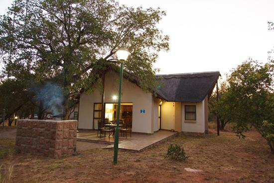 Phalaborwa Safari Park, A Forever Resort | self-catering holiday resort near Hoedspruit and Gravelotte at the gate to the Kruger National Park | self-catering, caravan park, camping, chalet accommodation | Limpopo | South Africa.: 5-Sleeper Chalet. 2 bedrooms (1 double bed, 1 single bed & 1 bunker bed)